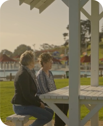 Two people sitting at a picnic table