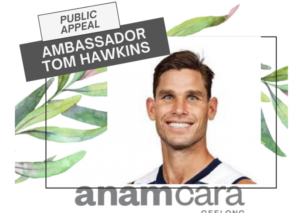 Geelong Cats player Tom Hawkins smiling, with decorative leaves